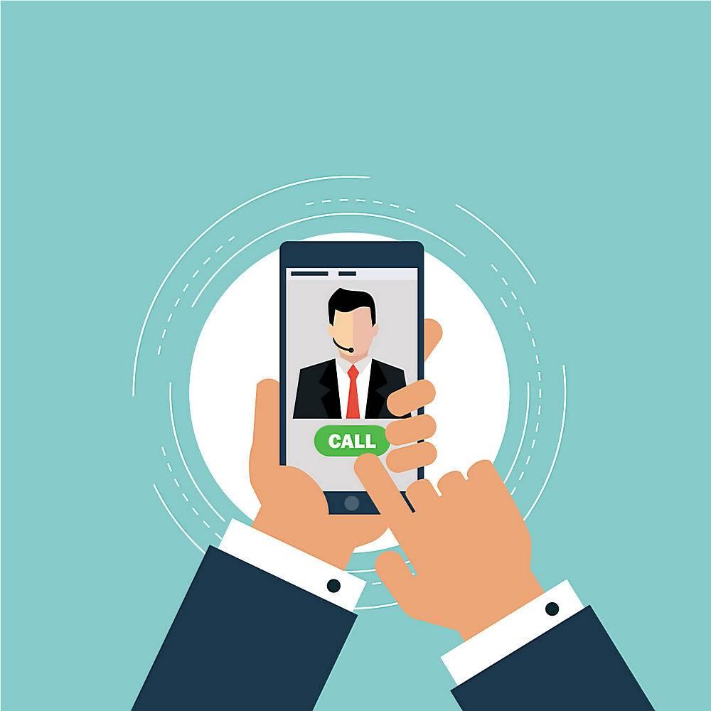 工作人员使用手机拨打电话_959057