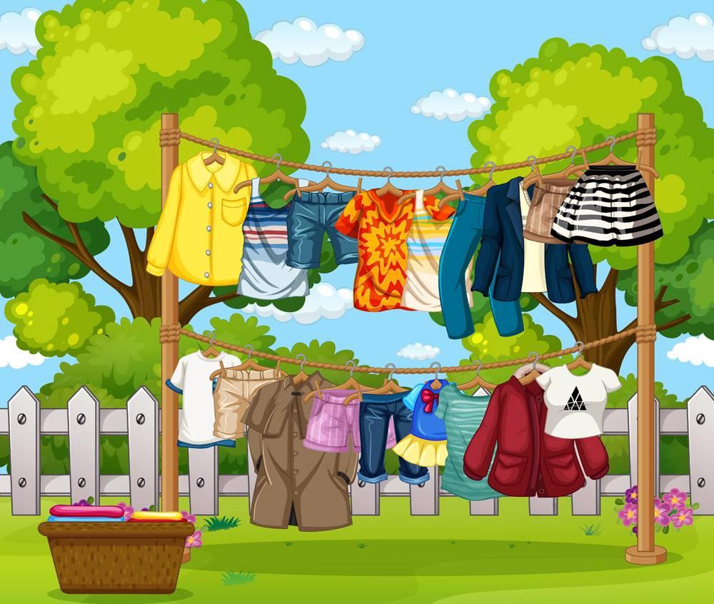 很多衣服挂在屋外的绳子上_11693517